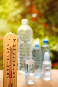 Water bottles and a thermometer with a high temperature